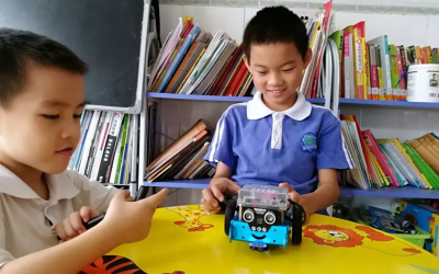 Not Only Textbooks in His School Bag! But also a Programmable Robot!